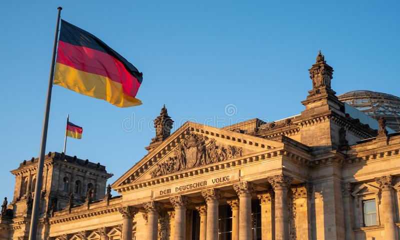 The Bundestag building, Parliament of the Federal Republic of Germany, with German flag flying outside. Photographed in the late afternoon during the June royalty free stock photo