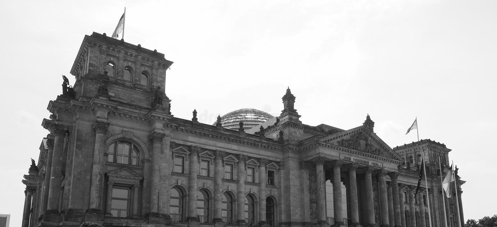Bundestag parliament in Berlin in black and white. Bundestag German Houses of Parliament in Berlin, Germany. Dem deutschen Volke means To the German people in stock photo