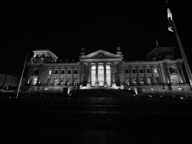 Bundestag parliament in Berlin at night in black and white. Bundestag German Houses of Parliament in Berlin, Germany at night. Dem deutschen Volke means To the royalty free stock images