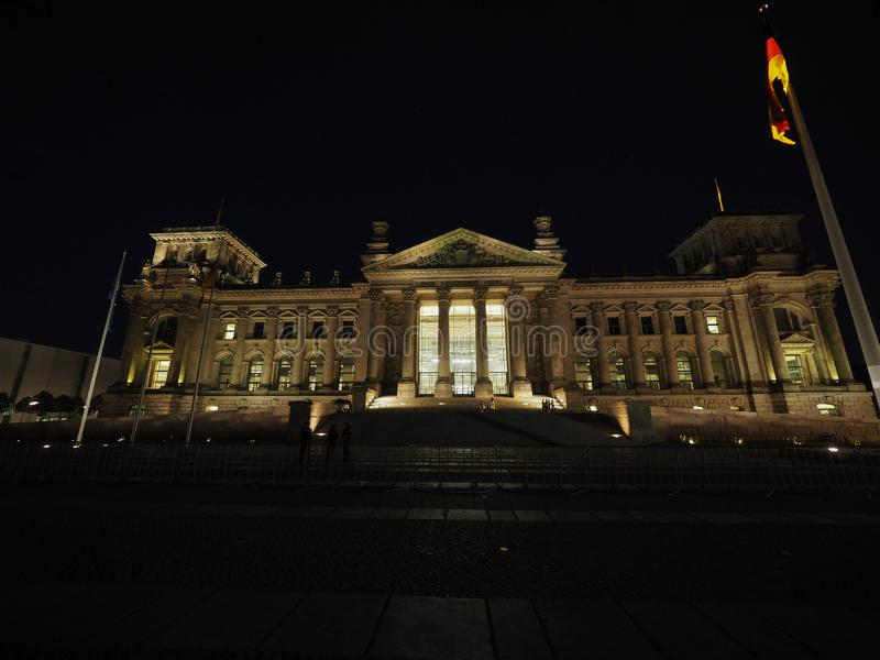 Bundestag parliament in Berlin at night. Bundestag German Houses of Parliament in Berlin, Germany at night. Dem deutschen Volke means To the German people stock images