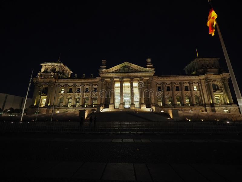 Bundestag parliament in Berlin at night. Bundestag German Houses of Parliament in Berlin, Germany at night. Dem deutschen Volke means To the German people stock photography