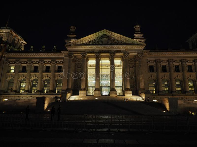 Bundestag parliament in Berlin at night. Bundestag German Houses of Parliament in Berlin, Germany at night. Dem deutschen Volke means To the German people royalty free stock photos