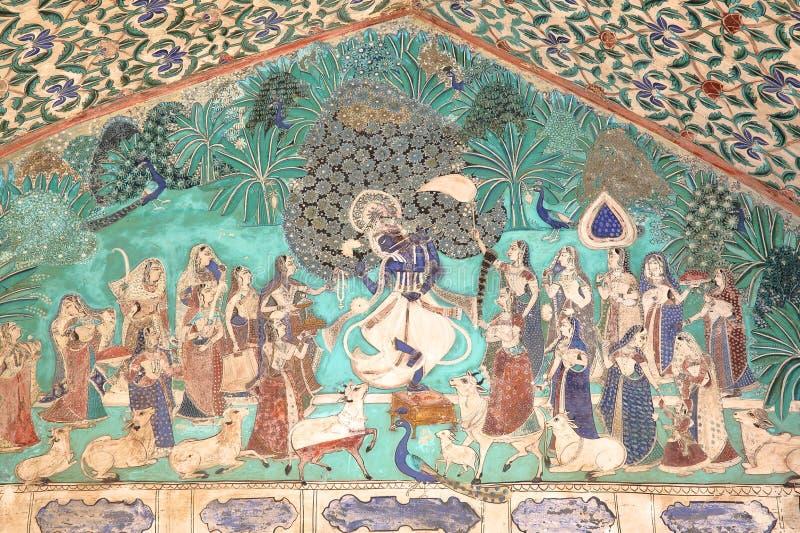 BUNDI, РАДЖАСТХАН, ИНДИЯ - 8-ОЕ ДЕКАБРЯ 2017: Стенные росписи на Chitrasala в дворце Garh Bundi показывая Krishna играя fl стоковое фото rf