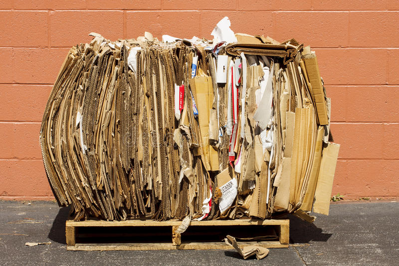 Bundle of Cardboard for Recycling. Bundle of cardboard crushed and packed for recycling royalty free stock photo