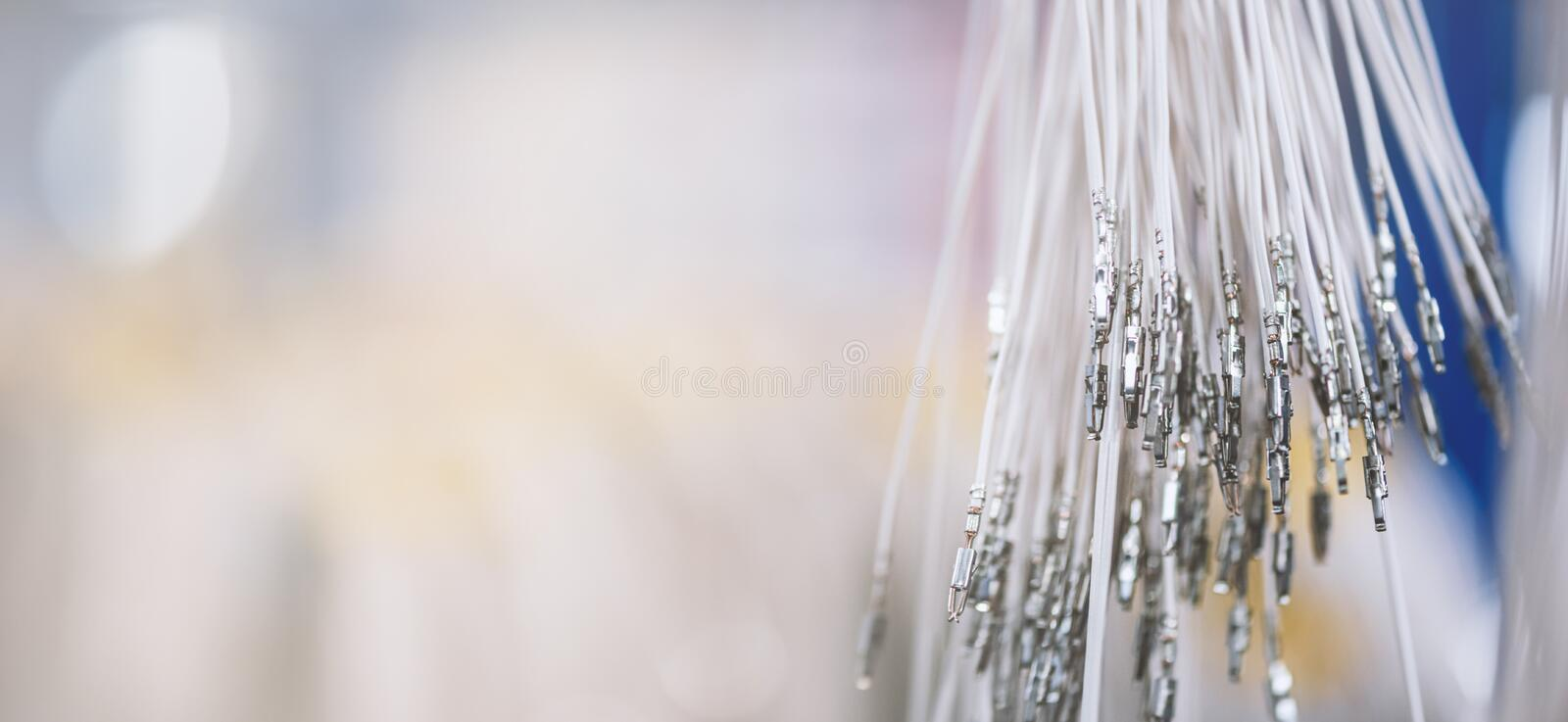 Bundle of crimped cables with blade connectors. Electrical contacts. Terminated wire ready to creation connection. Industrial background with copy space for royalty free stock photography