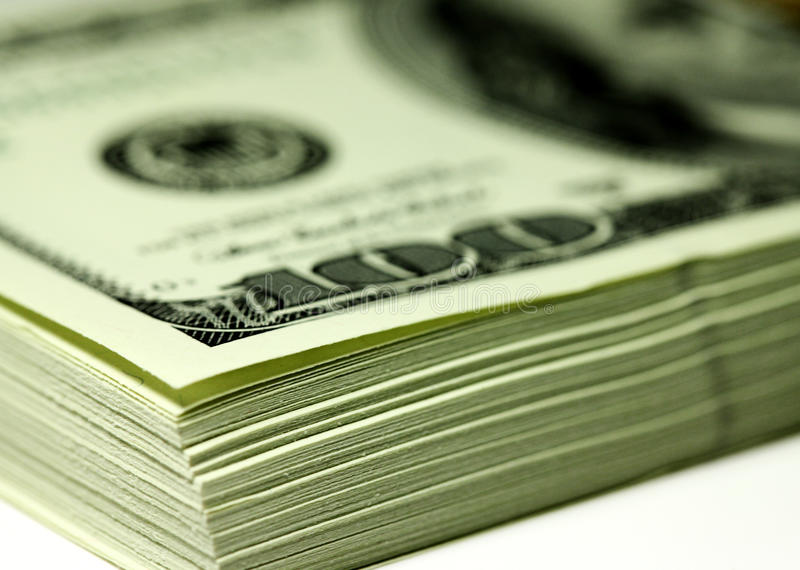 Bundle of dollars. A stack of new banknotes $ 100 royalty free stock photo