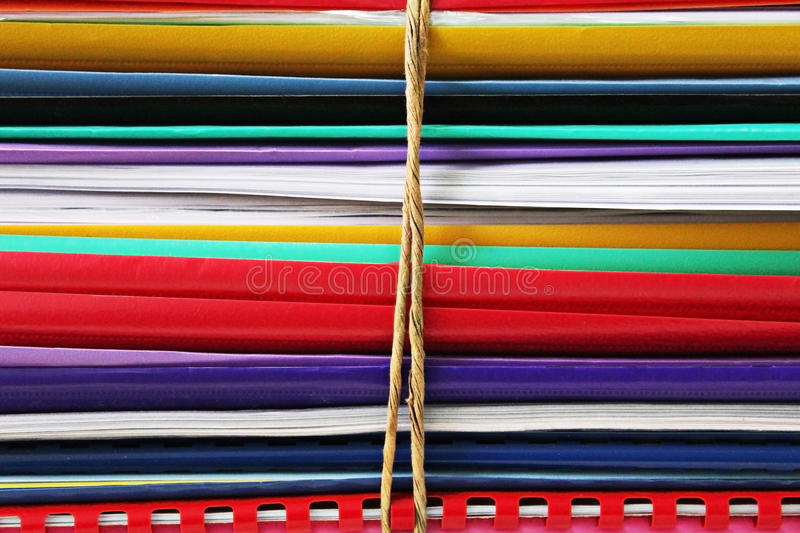 Bundle of folders. Big bundle of colourful folders and papers stock image