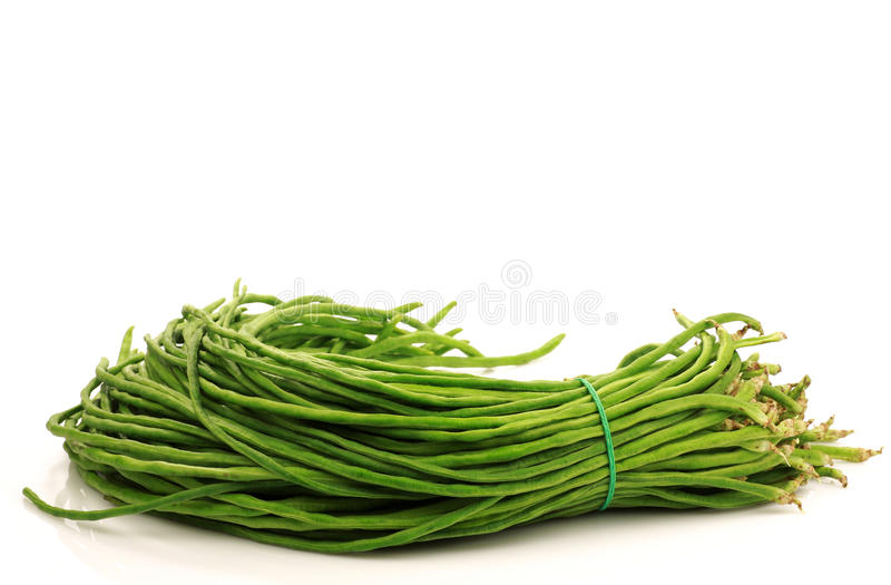 Bundle of fresh long beans. (Vigna unguiculata subsp. sesquipedalis) on a white background royalty free stock photography