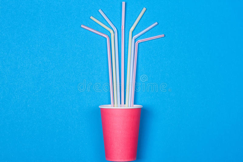 A bundle of multi-colored drinking straws in a paper Cup royalty free stock image