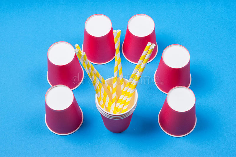 A bundle of multi-colored drinking straws in a paper Cup stock images