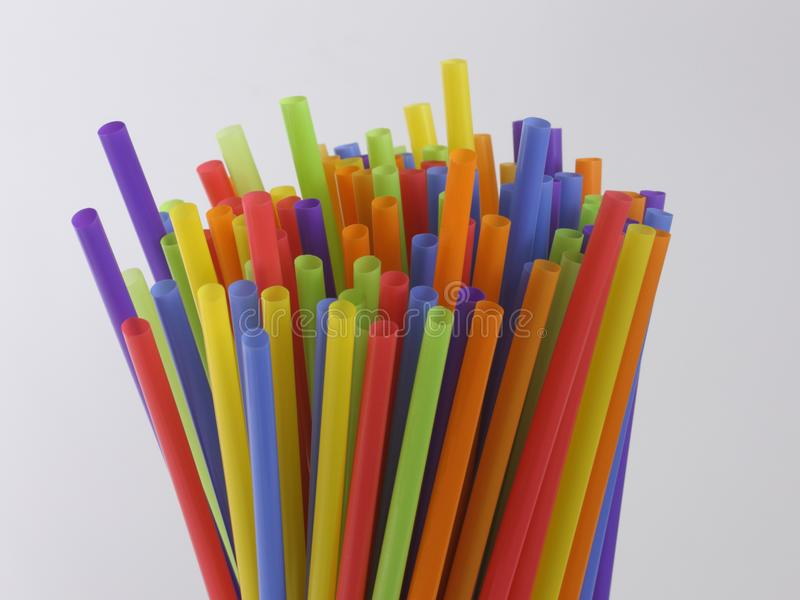 Bundle of Multi-colored Plastic Straws Sticking Up stock photos