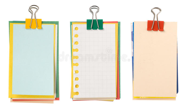 Bundle of paper. Three bundles of paper with a clip isolated on white