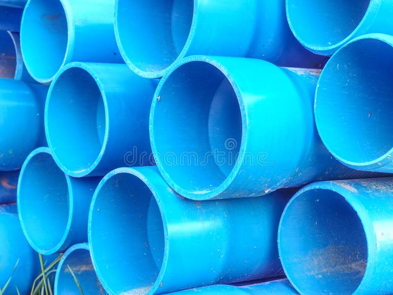 Bundle of plastic pipes ready for local water transit renewal royalty free stock photos