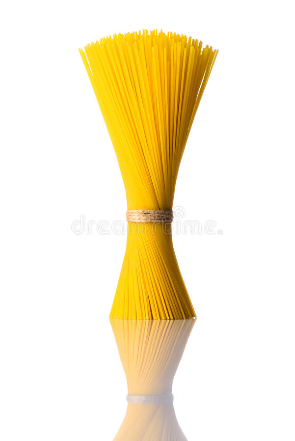 Bundle Yellow Spaghetti Pasta on White Background royalty free stock photos