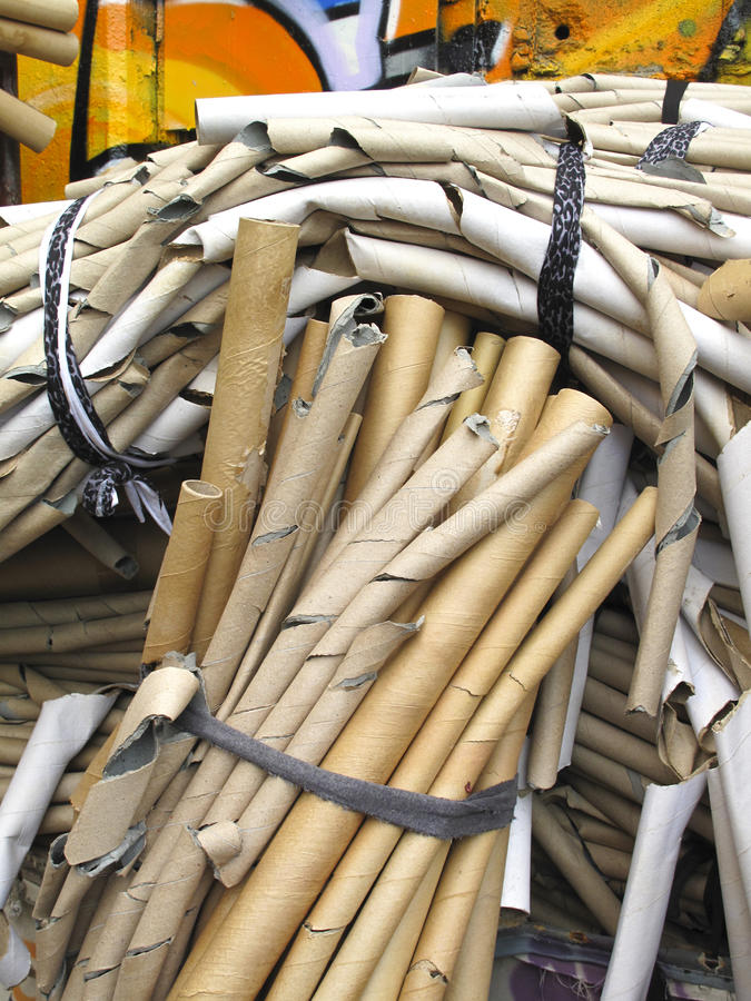 Bundles of cardboard tubes stock image