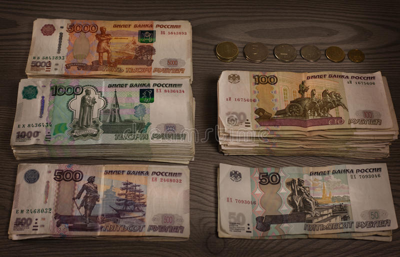 Bundles of money. Russian rubles on a wooden background. royalty free stock photos