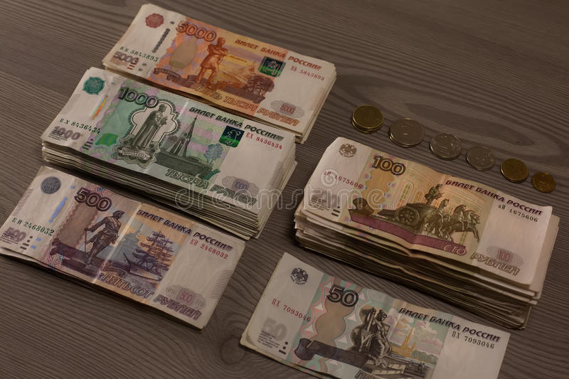 Bundles of money. Russian rubles on a wooden background. stock photography