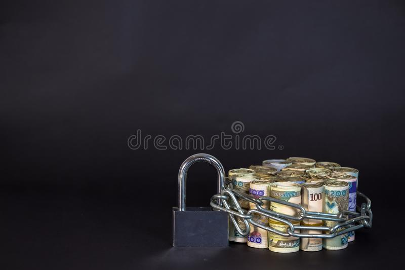 Bundles of naira cash chained and padlock concept of Esecurity stock images