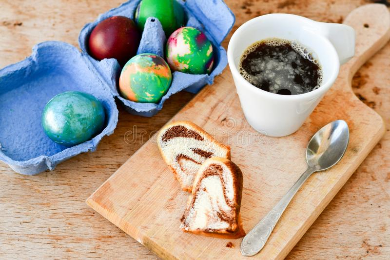Bundt easter marble cake, blue easter egg and cup of coffee stock images