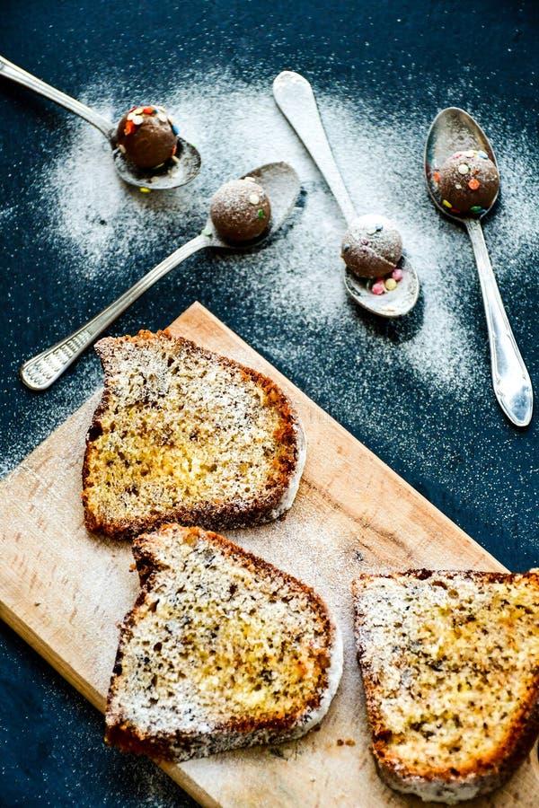 Bundt lemon cake ,cup of coffee and chocolate pralines royalty free stock photo