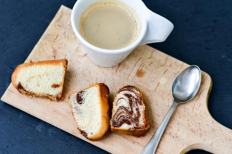 Bundt lemon cake and cup of coffee stock photography