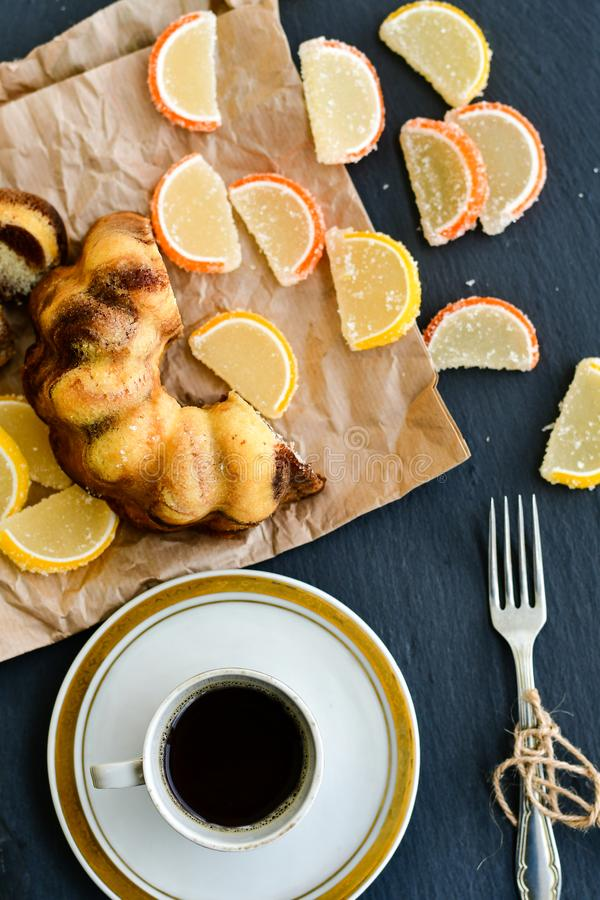 Bundt marble cake,cup of coffee and lemon slices stock photos