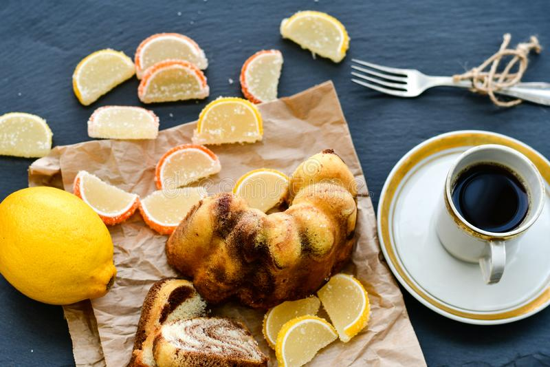 Bundt marble cake,cup of coffee and lemon slices stock image