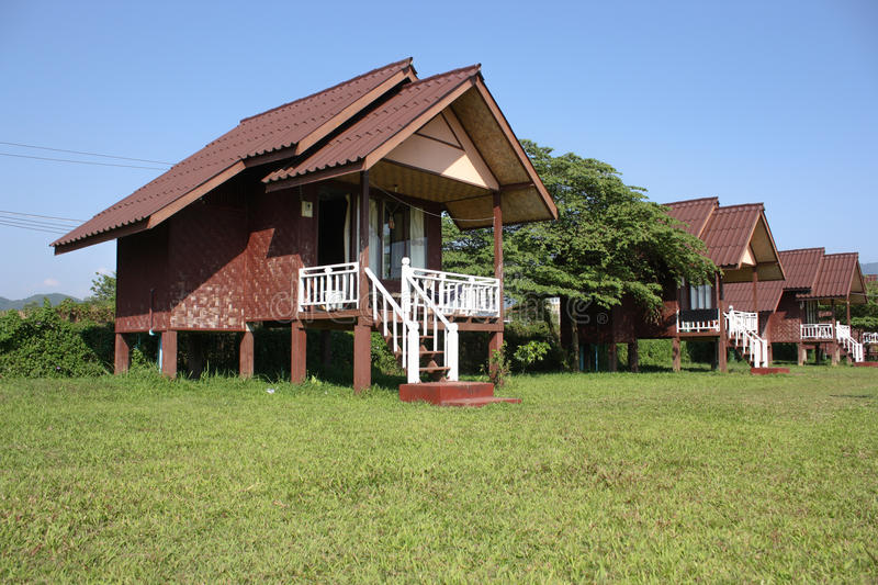 Bungalow. With blue sky and green grass stock photos