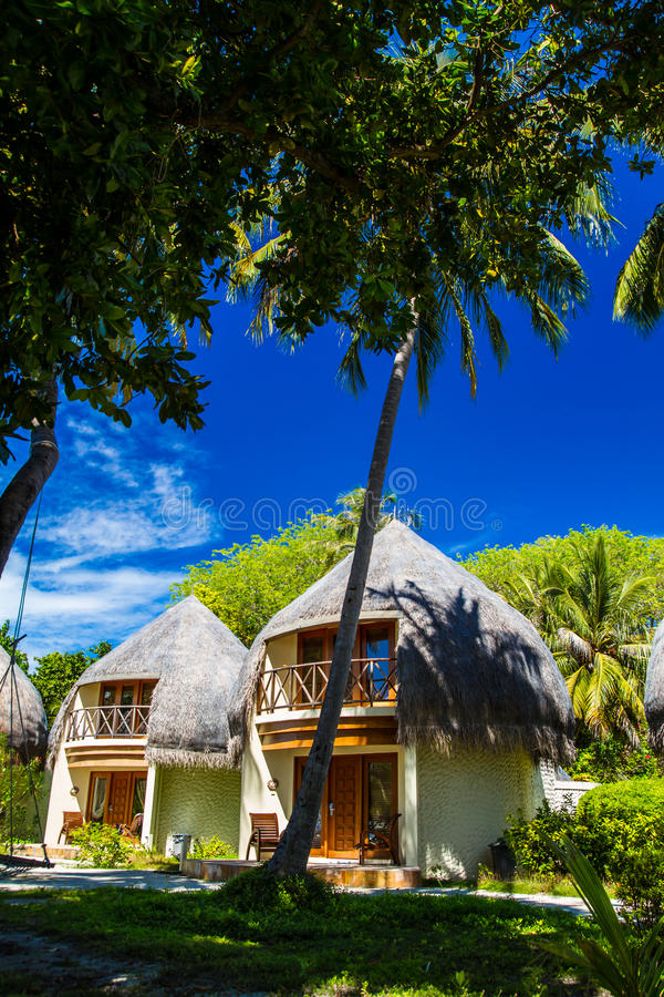 Bungalow on the coral beach. Concept of romantic holidays royalty free stock photos