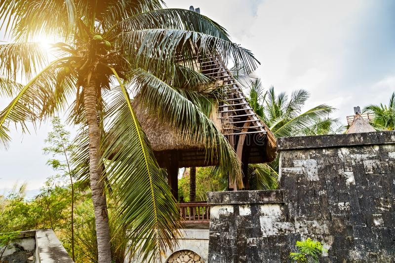 Bungalow Eco hotel resort tourism concept. Bungalow house Straw Roof tourism concept nature background wooden hut tropics in the local village stock images