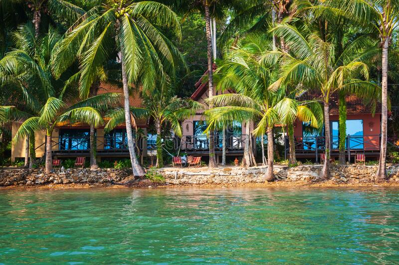 Bungalows on the beach of tropical island royalty free stock image