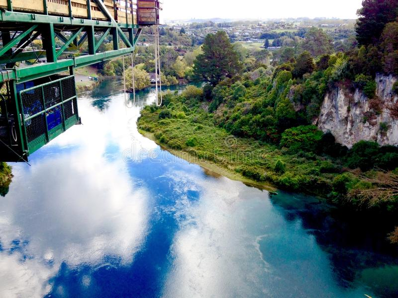 Bungee bungy jumping platform over Waikato River, Taupo, New Zealand. A scenic downwards look from the level of the bungee bungy jumping platform that sits 47 royalty free stock photos