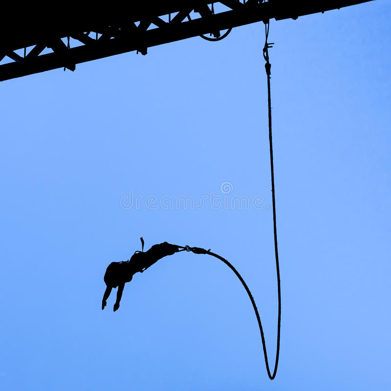 Bungee jumper against blue sky stock photo
