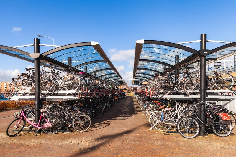 Bunk parking lot for bicycles. Almere, Netherlands - February 24, 2017: Bunk parking lot for bicycles near the train station Almere Port stock photo