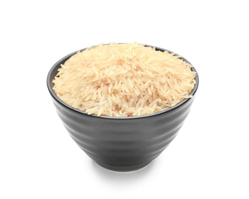Bunke med förvällde ris på vit bakgrund arkivfoto