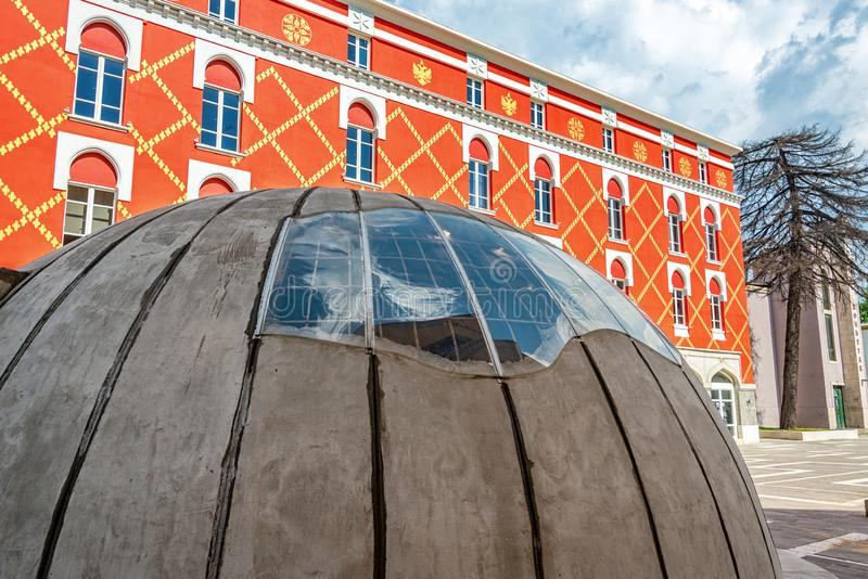 Bunker in the Center of Tirana, Albania. Bunker in downtown Tirana, Albania with the Ministry of Urban Development in the background stock photography