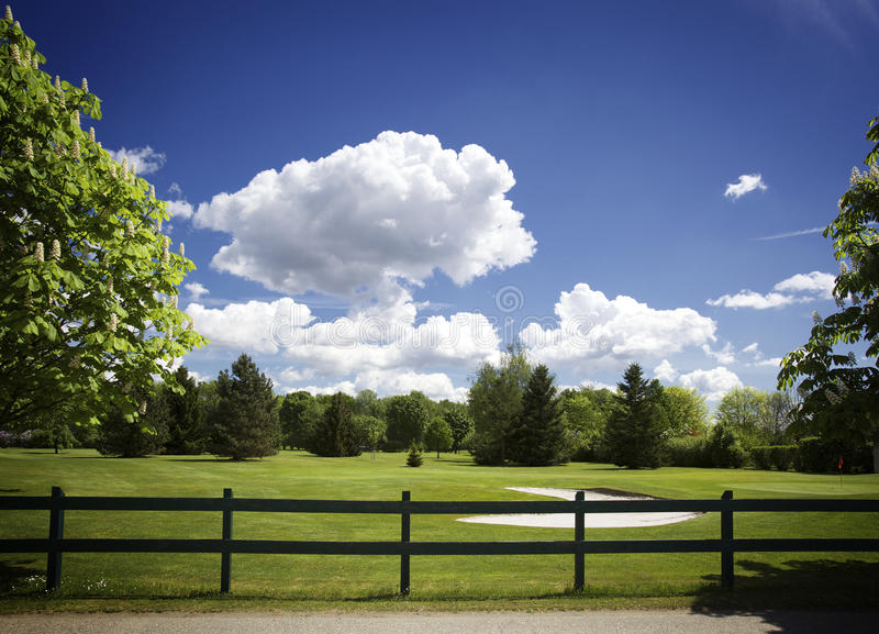Download Bunker On Golf Course, Fence And Cloudy Sky Stock Image - Image: 14420787
