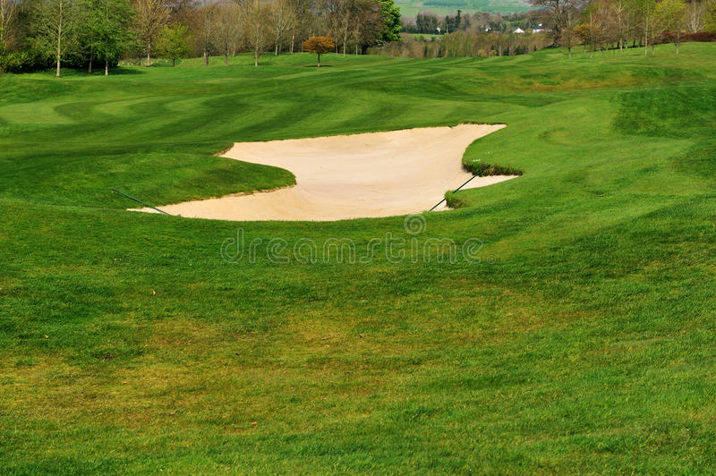 Bunker with sand on a golf course royalty free stock photography