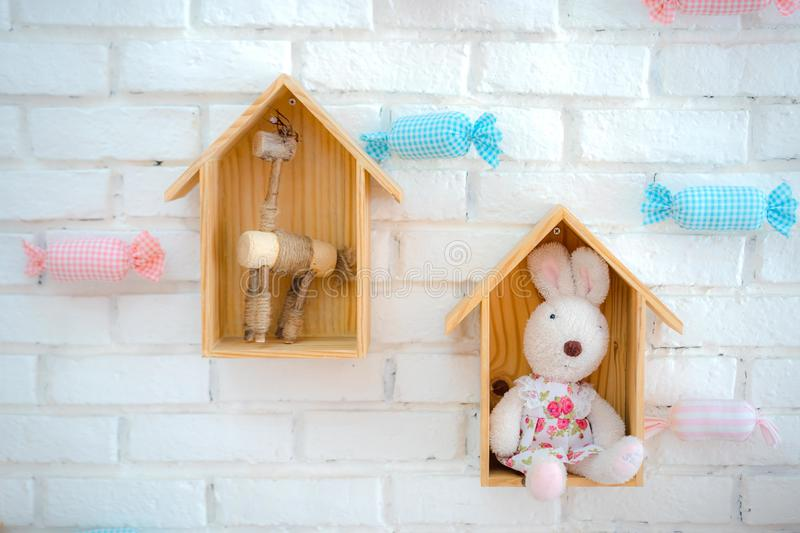 Bunny house on white background. White rabbit in wood house stock images
