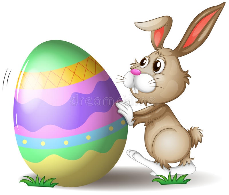 A bunny pushing an easter egg. Illustration of a bunny pushing an easter egg on a white background royalty free illustration