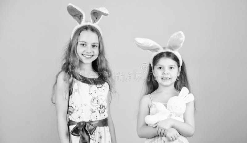 The bunny rabbits are so cute. Happy children celebrating Easter. Children in Easter bunny style holding hearts. Small royalty free stock photo