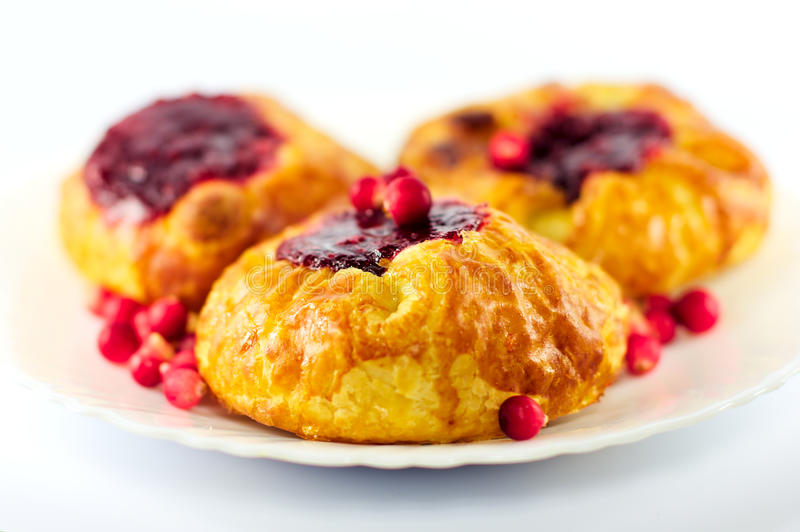 Buns and berries royalty free stock photography