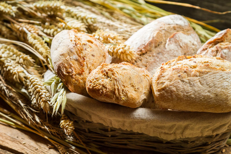 Buns made of whole wheat flour in basket royalty free stock images