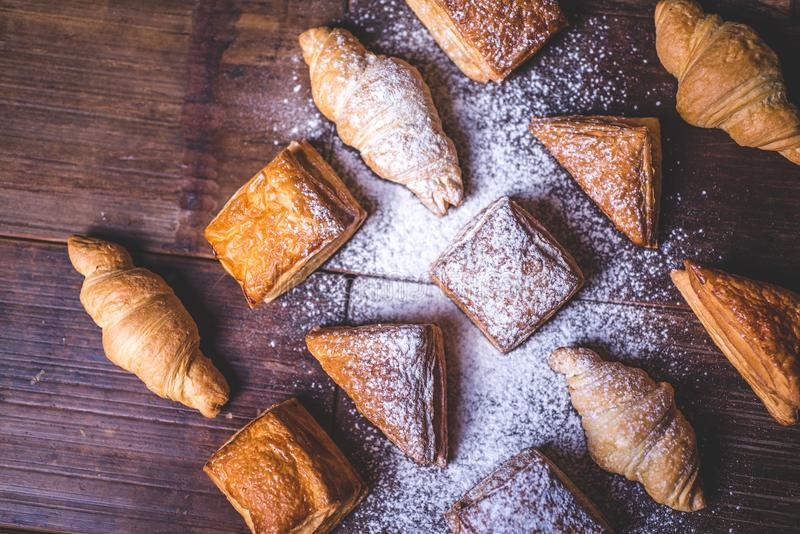 Buns from puff pastry sprinkled with powdered sugar. stock images