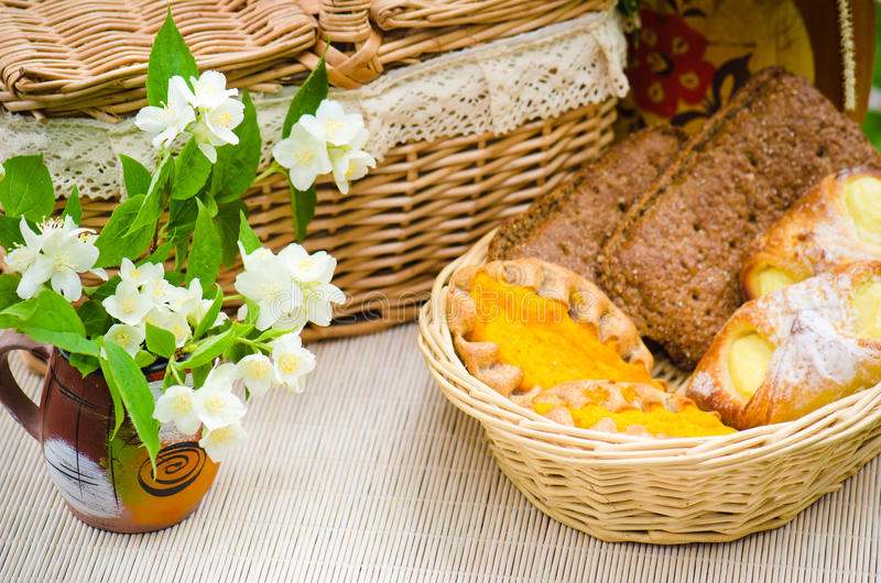 Download Buns In A Wicker Basket And Bouquet Of Jasmine Flowers Stock Photography - Image: 32613432