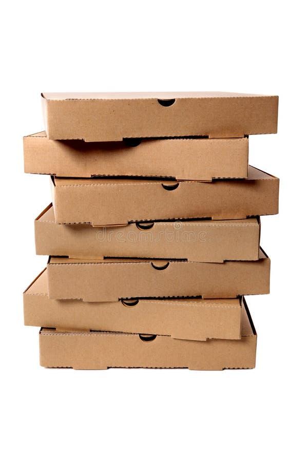 Bunt av bruna pizzaaskar arkivfoton