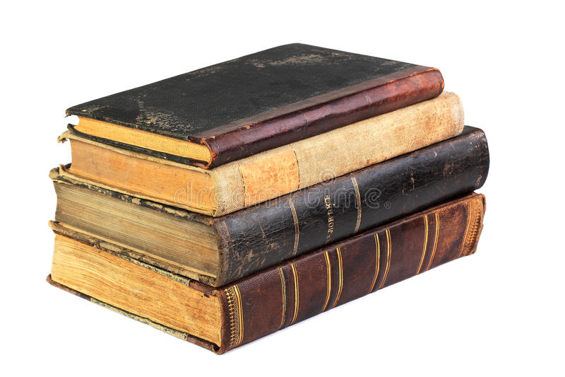 Bunt av gamla böcker som isoleras på vit royaltyfri fotografi