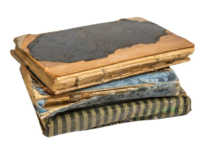 Bunt av gamla böcker som isoleras på vit bakgrund gammalt arkiv royaltyfri fotografi