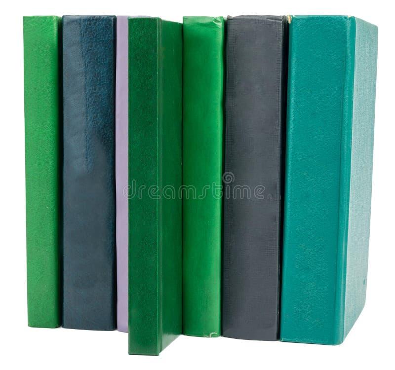 Bunt av gammala böcker som isoleras på white royaltyfri foto