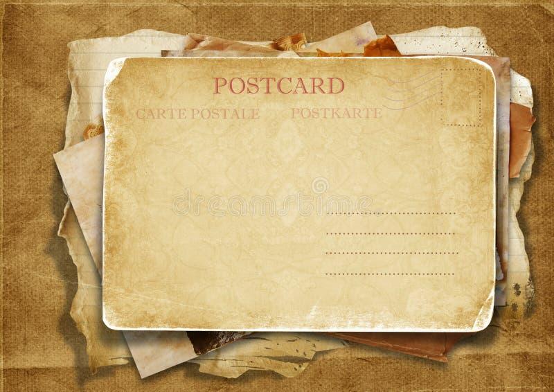 Bunt av gammala papperen med en vykort royaltyfri illustrationer